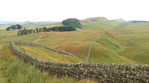 Hadrian's wall winding though farmland