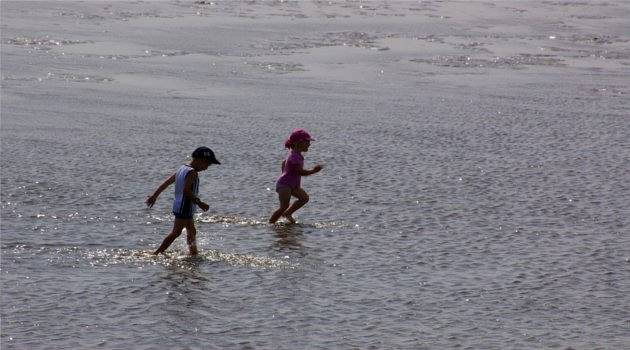 Two kids dash out to sea