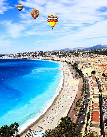 Hot air balloons over beach in Nice