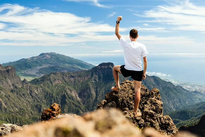 Trail runner on top of mountain